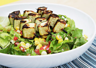 Butter lettuce salad with grilled zucchini skewers and tomato vinaigrette